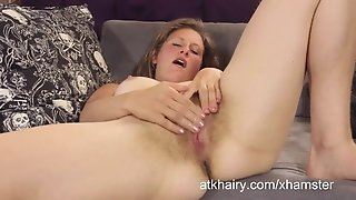 Shoshannah fingers her unshaved pussy for an orgasm